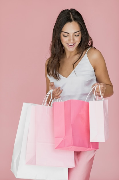 Nice woman looking into pink shopping net Free Photo