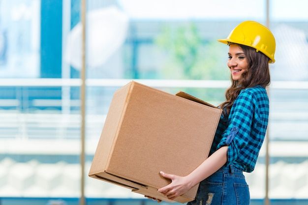 Nice young woman carrying box Premium Photo