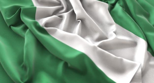 Nigeria flag ruffled beautifully waving macro close-up shot Free Photo