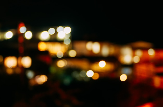 Night city lights in defocus. abstract background. Photo ...