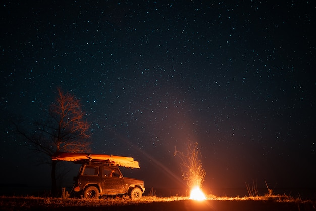 Night landscape with bright campfire and car Free Photo