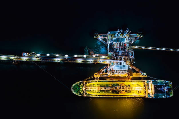 Night shot oil tanker shipping loading in oil station import and export  logistics transportation business top view Premium Photo