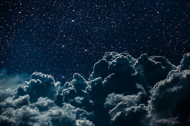 Premium Photo | Night sky with stars and moon and clouds.