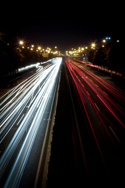 Night traffic on the highway Free Photo