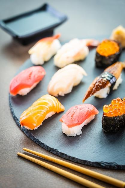 Nigiri sushi set with salmon tuna shrimp prawn eel shell Free Photo