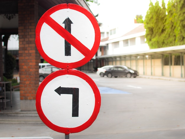 No passing traffic sign and turn left at the public car park. Premium Photo
