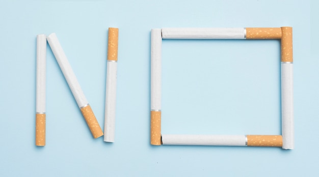 No text made with cigarettes against blue backdrop Free Photo