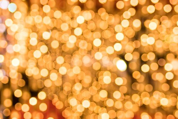 輝く金色のボケの背景のクローズアップ 無料写真
