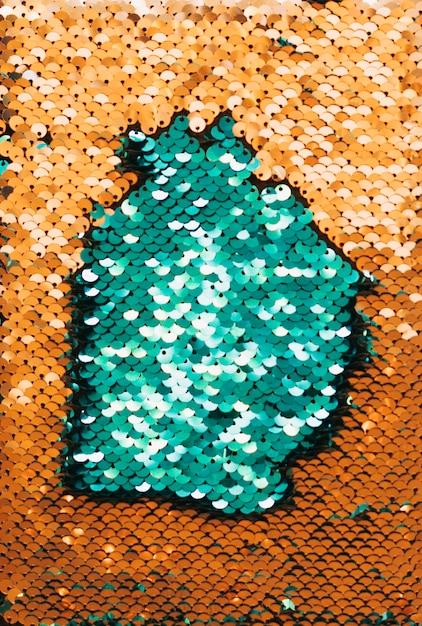 緑と金色の反射スパンコールのフルフレームの抽象的な背景 無料写真