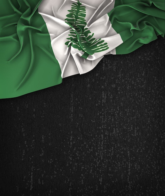 Norfolk island flag vintage on a grunge black chalkboard with space for text Premium Photo