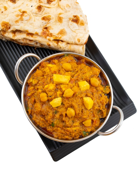 North indian healthy cuisine chole paneer on white background Premium Photo