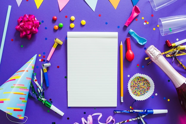 Notebook and party decorations Free Photo