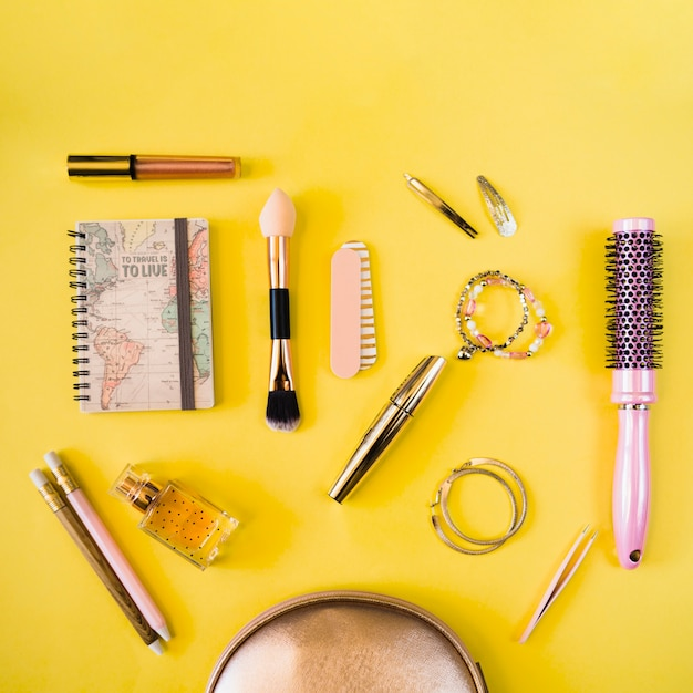 Notebook and beauty supplies Free Photo