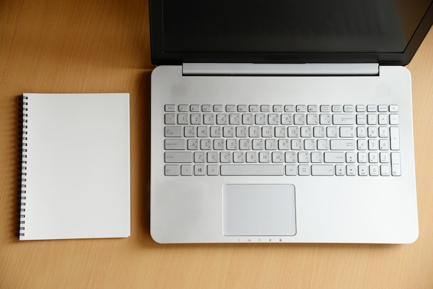 Notebook and computer laptop on wood Premium Photo
