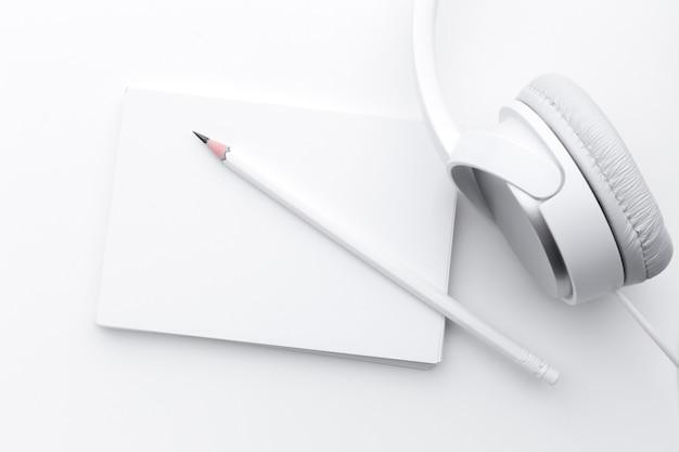 Notebook, earphones and pencil Premium Photo