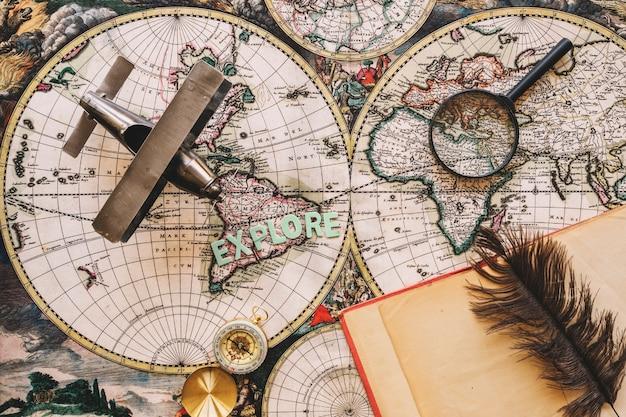 Notebook and feather near tourist stuff Free Photo