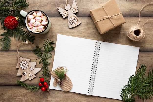 Notebook mock-up surrounded by christmas decorations Free Photo