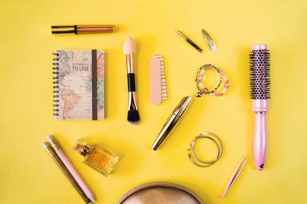Notebook near cosmetics and hairdressing supplies Free Photo