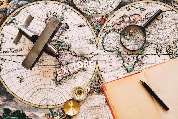 Notebook near tourist stuff and explore writing Free Photo