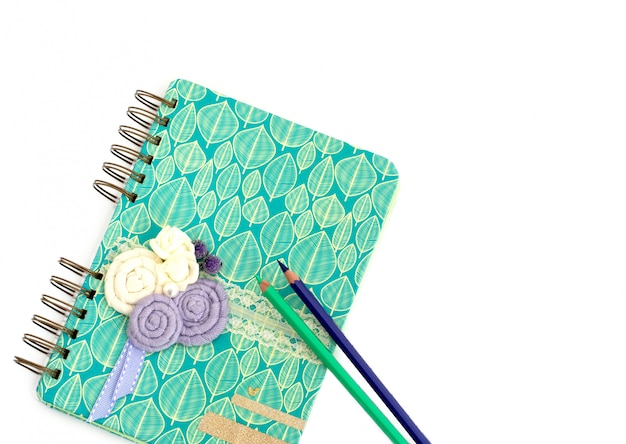 Notebook and pen on white background Premium Photo