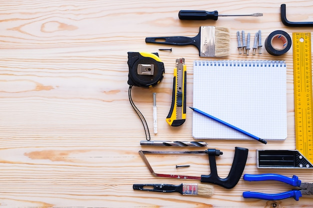 Notebook for records and construction tools for building a house or apartment renovation Premium Photo