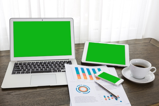 Notebook, tablet and mobile with green screen Free Photo