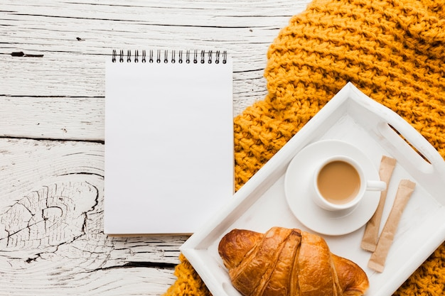 Notebook and tray with breakfast Free Photo