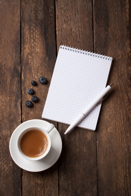 Notebook With A Pen Next To Cup Of Coffee Photo Free