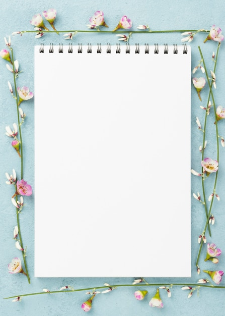 Notebook with branches of flowers Free Photo