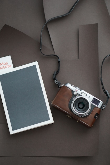 Notebook with camera. top view. on the tab page of the book the inscription my love. Premium Photo