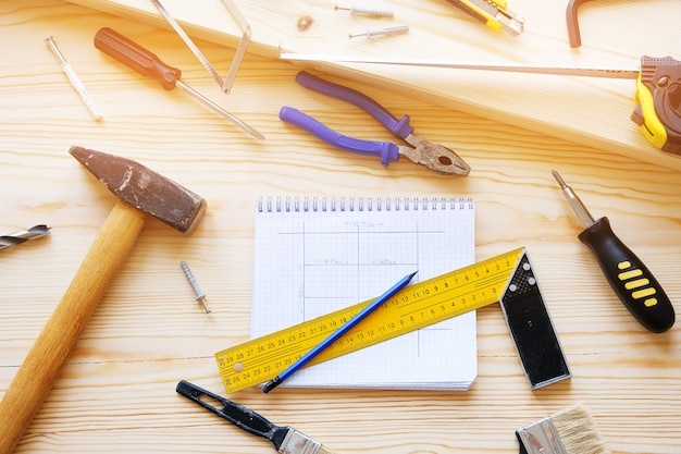Notebook with drawings and construction tools for building a house or apartment repair. Premium Photo