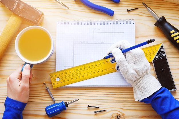 Notebook with drawings and construction tools for repair Premium Photo
