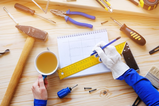 Notebook with drawings and construction tools. Premium Photo