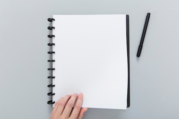 Notebook with pen on desk Free Photo