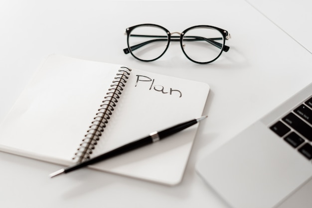 Notebook with plan Premium Photo