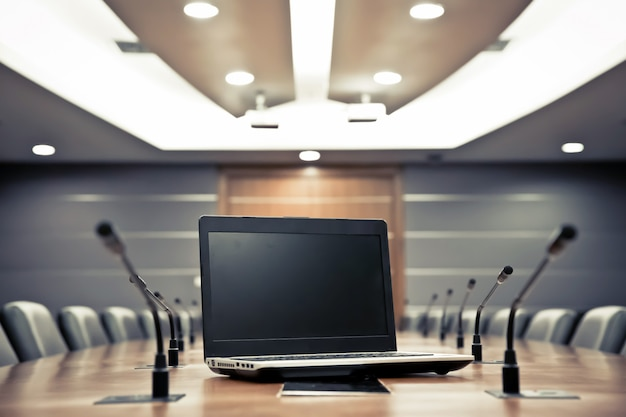 Notebook with professional microphone in the meeting room Premium Photo