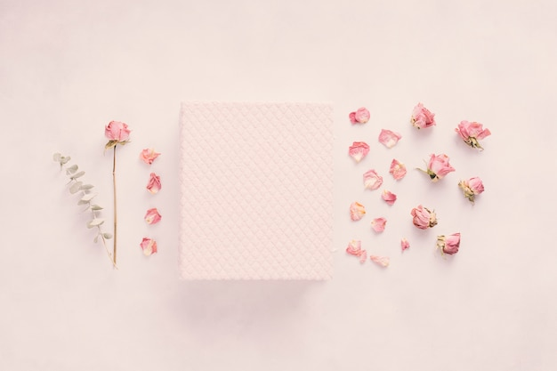 Notebook with rose flower on table Free Photo