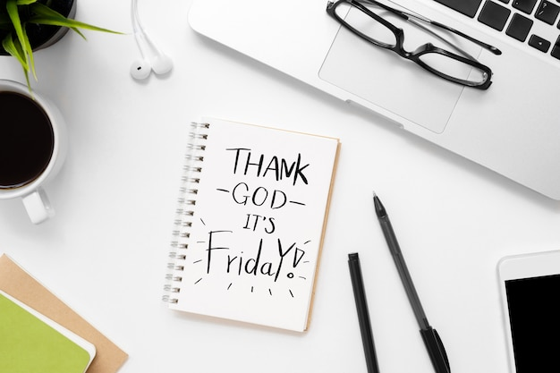 Notebook with thank god it's friday text on it. Premium Photo
