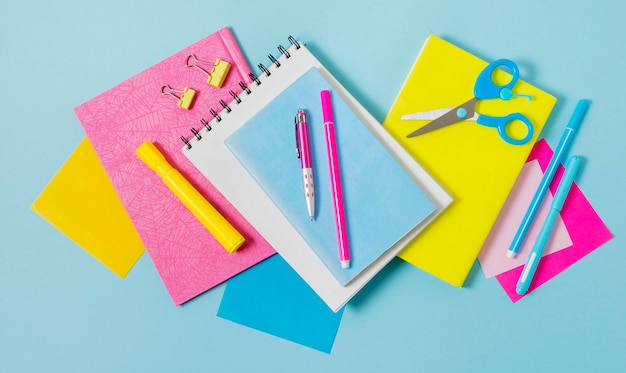 Notebooks and pens arrangement Free Photo