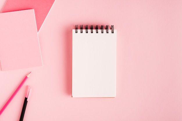 Notepad and office supplies on colored surface Free Photo