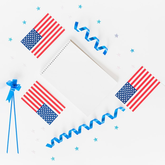 Notepad small american flags and holiday decoration Free Photo