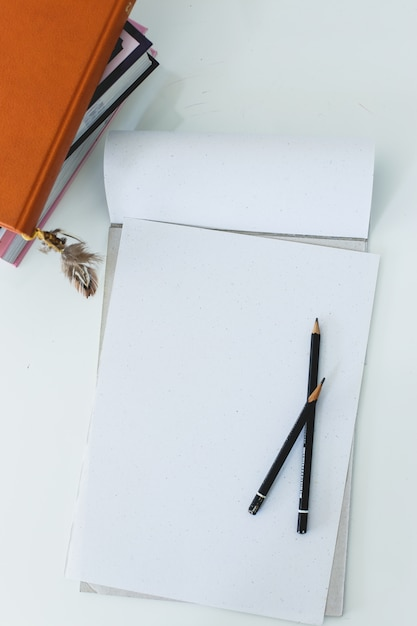 Notepad on the table Free Photo