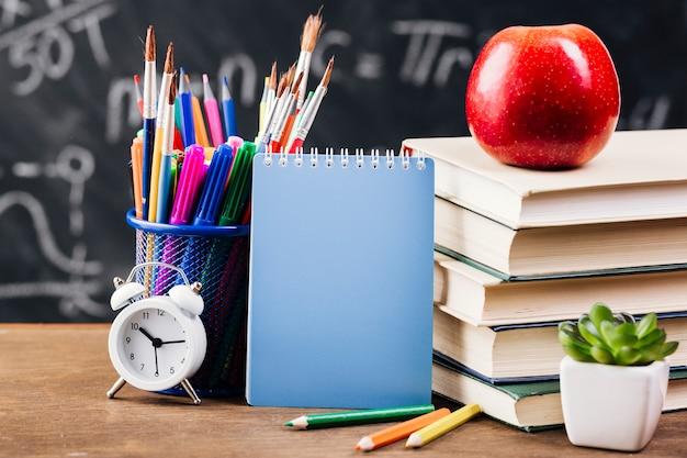 Notepad at teacher desk Free Photo