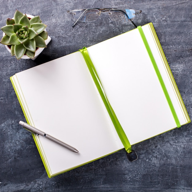 Notepad with pen, glasses , and flower business concept . Premium Photo