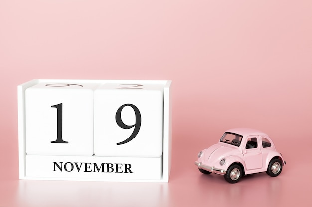November 19th. day 19 of month. calendar cube with car Premium Photo