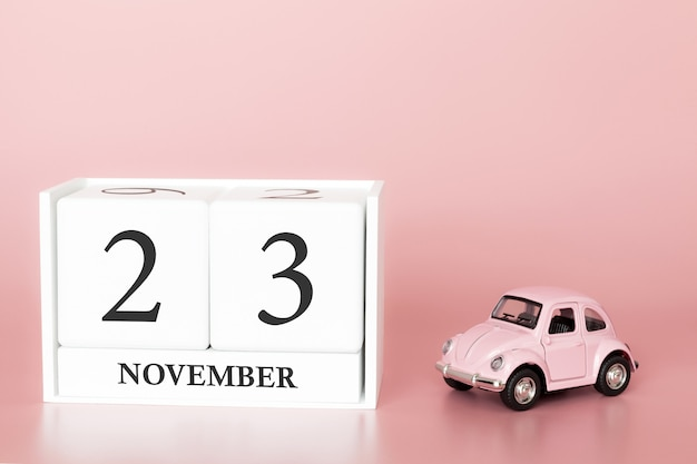 November 23rd. day 23 of month. calendar cube with car Premium Photo