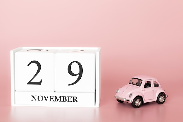 November 29th. day 29 of month. calendar cube with car Premium Photo