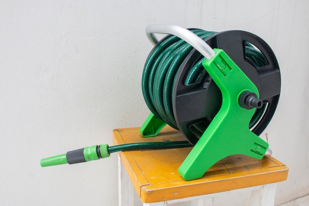 Nozzle of gardening water hose on concrete Premium Photo