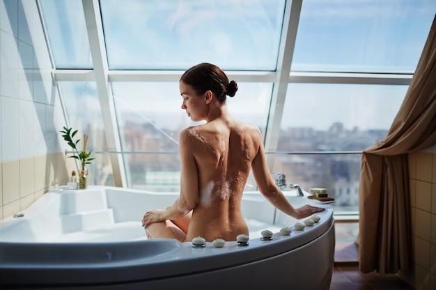 Nude tub back naked care Premium Photo