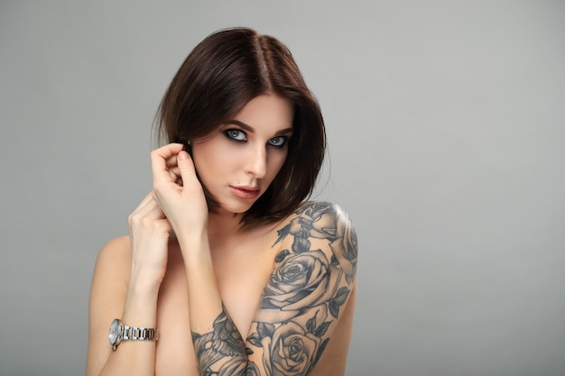 Nude woman with tattoo posing Free Photo